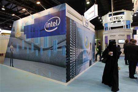 People walk past the Intel stand on the first day of the Gulf Information and Technology Exhibition (GITEX) at the Dubai World Trade Centre in Dubai October 14, 2012. REUTERS/Jumana ElHeloueh/Files