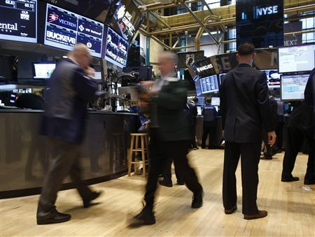 Trading specialists hurry around on the floor of the New York Stock Exchange, November 19, 2012. REUTERS/Chip East