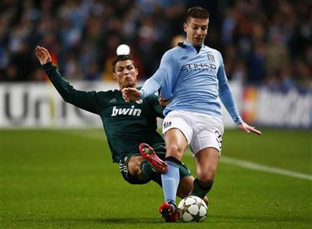 Manchester City's Matija Nastasic (R) is challenged by Real Madrid's Cristiano Ronaldo during their Champions League Group D soccer match at The Etihad Stadium in Manchester, northern England, November 21, 2012. REUTERS/Darren Staples
