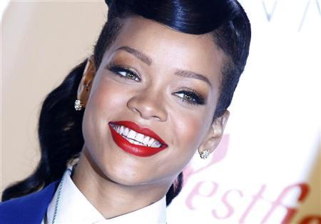 Singer Rihanna poses before an appearance to switch on the Christmas lights at Westfield shopping centre in Stratford, east London November 19, 2012. REUTERS/Luke MacGregor