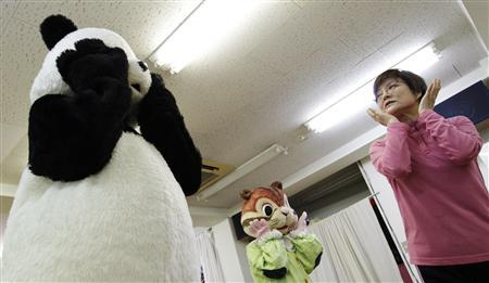 Choko Oohira (R) teaches trainees in character mascots at the Choko Group mascot school in Tokyo, November 20, 2012. REUTERS/Yuya Shino