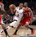 Oklahoma City Thunder guard Russell Westbrook passes Los Angeles Clippers guard Chris Paul (R) in the first half of their NBA basketball game in Oklahoma City, Oklahoma November 21, 2012. REUTERS/Bill Waugh