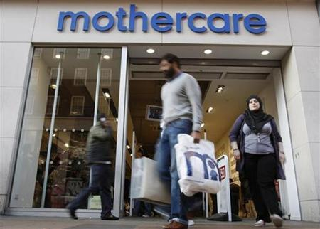 Customers leave a Mothercare shop in London October 11, 2008. REUTERS/Suzanne Plunkett