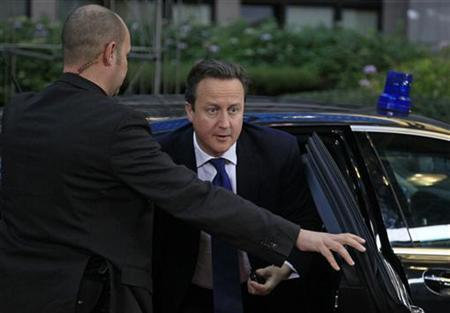 Britain's Prime Minister David Cameron arrives at the EU council headquarters for an European Union leaders summit discussing the European Union's long-term budget in Brussels November 22, 2012. REUTERS/Yves Herman