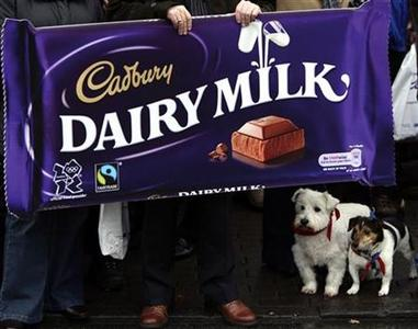 Workers protest after attending a union campaign launch at the Cadbury factory in Bournville, central England, December 15, 2009. REUTERS/Darren Staples/Files