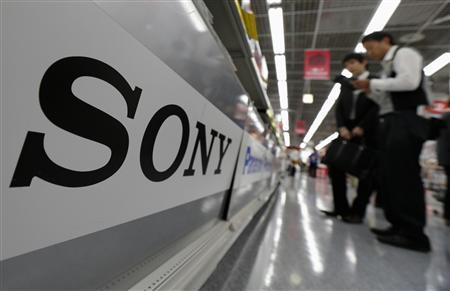A Sony logo is seen as customers look at Sony digital cameras at an electronics shop in Tokyo, in this May 10, 2012 file photo. REUTERS/Kim Kyung-Hoon/Files