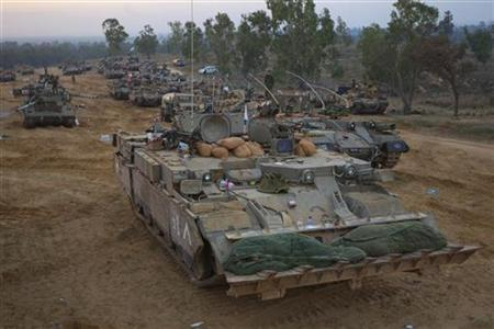 Israeli soldiers sleep in their sleeping bags on an Armoured Personnel Carrier (APC) at a staging area outside the central Gaza Strip November 22, 2012. REUTERS/Ronen Zvulun