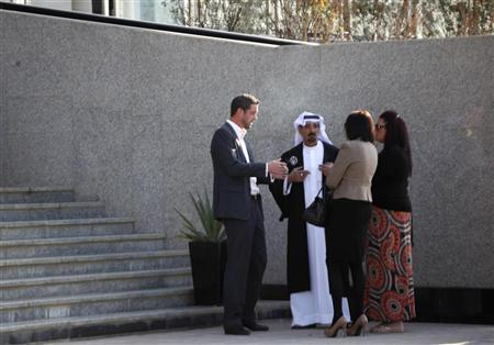 Rebecca Blake (2nd R) and Conor McRedmond (L) stand with their lawyer Shaker Al Shammary (2nd L) outside the Dubai Courts ahead of a court hearing November 1, 2012. REUTERS/Jumana ElHeloueh