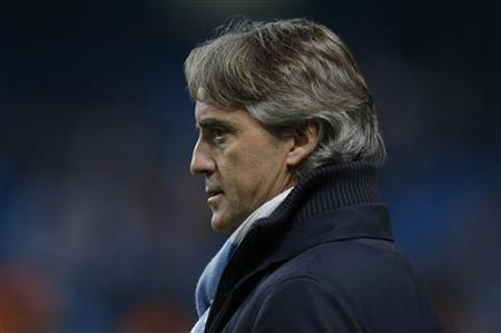 Manchester City's manager Roberto Mancini watches the warmup before the Champions League Group D soccer match against Real Madrid at The Etihad Stadium in Manchester, northern England November 21, 2012. REUTERS/Phil Noble