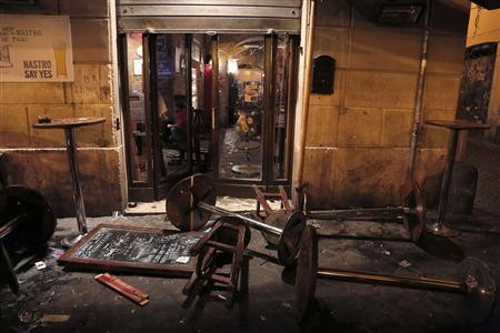 A pub is seen damaged after a fight in downtown Rome November 22, 2012. REUTERS/Yara Nardi