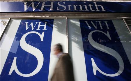 Pedestrians walk past a WH Smith shop, in London October 6, 2008. REUTERS/Alessia Pierdomenico