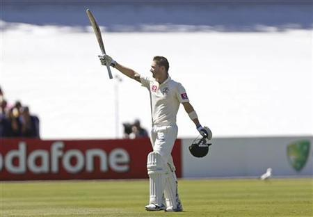 Australia's captain Michael Clarke celebrates reaching a century during their second cricket test match against South Africa at the Adelaide cricket ground November 22, 2012. REUTERS/Regi Varghese