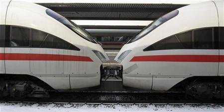 Two InterCityExpress (ICE) high-speed trains of German railways Deutsche Bahn (DB) are seen in Munich February 7, 2012. REUTERS/Michael Dalder