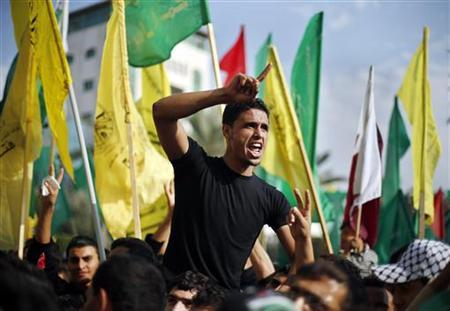 A Palestinian celebrates what they say is a victory over Israel after an eight-day conflict during a rally in Gaza City November 22, 2012. REUTERS/Suhaib Salem