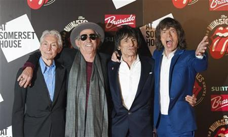 The Rolling Stones (L-R) Charlie Watts, Keith Richards, Ronnie Wood and Mick Jagger pose as they arrive for the opening of the exhibition ''Rolling Stones: 50'' at Somerset House in London July 12, 2012. REUTERS/Ki Price/Files