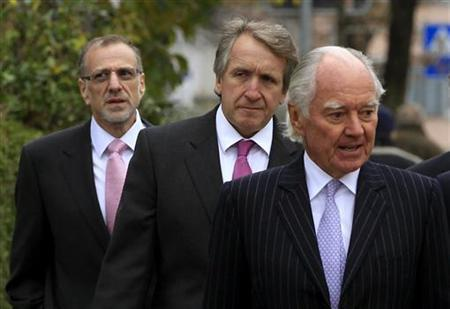Xstrata Chairman John Bond (R-L), CFO Trevor Reid and CFO Mick Davis arrive before an extraordinary shareholder meeting in the Swiss town of Zug November 20, 2012. Shareholders in miner Xstrata are expected to give the green light on Tuesday to a long-awaited $31-billion takeover by commodities giant Glencore , paving the way for one of the largest tie-ups in the sector to date. REUTERS/Arnd Wiegmann (SWITZERLAND - Tags: BUSINESS HEADSHOT)