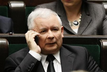 Jaroslaw Kaczynski, leader of Poland's main opposition Law and Justice (PiS) party, speaks on his mobile phone as he attends a speech of Poland's Prime Minister Donald Tusk at the parliament in Warsaw November 18, 2011. REUTERS/Kacper Pempel