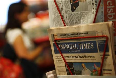 An edition of the Financial Times Deutschland (Germany) is seen at a shop in Frankfurt August 28, 2012. Local media reported that Financial Times are to modify the amount of pages in their newspaper. REUTERS/Kai Pfaffenbach (GERMANY - Tags: BUSINESS MEDIA)