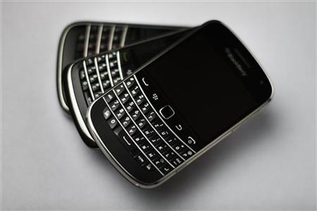 The Research in Motion (RIM) BlackBerry 9900 smartphone handset is stacked on top of other Blackberry smartphones in this illustration picture taken in Lavigny, July 21, 2012. Picture taken July 21, 2012. REUTERS/Valentin Flauraud