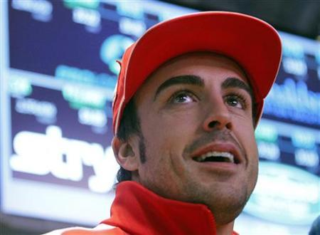 Ferrari Formula One driver Fernando Alonso (C) of Spain rings the closing bell at the New York Stock Exchange, November 20, 2012. REUTERS/Brendan McDermid