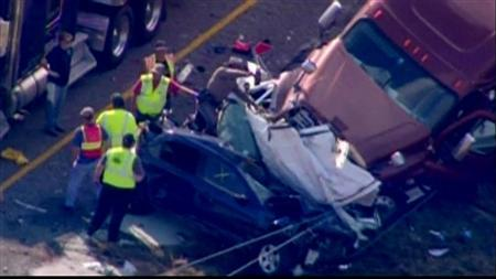 Emergency personnel, on the scene of a pileup of 80 to 100 vehicles on a foggy Texas interstate near Beaumont, are pictured in this still image taken from video courtesy of KPRC-TV, November 22, 2012. REUTERS/KPRC-TV/Handout
