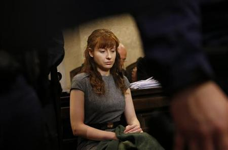 Estibaliz Carranza, a 34-year-old Mexican-Spanish woman, sits in a courtroom on the last day of her trial in Vienna November 22, 2012. REUTERS/Leonhard Foeger