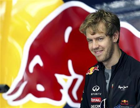 Red Bull Formula One driver Sebastian Vettel of Germany walks at the Interlagos racetrack to prepare for Sunday's Brazilian Grand Prix F1 race, in Sao Paulo November 22, 2012. REUTERS/Paulo Whitaker