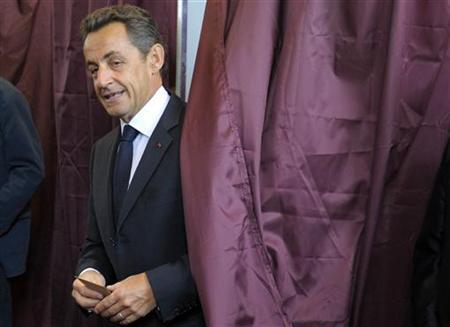 Former French President Nicolas Sarkozy leaves the voting booth at a polling station in Paris June 10, 2012. REUTERS/Philippe Wojazer/Files