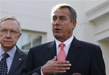 Speaker of the House John Boehner speaks next to Senate Majority Leader Harry Reid (L) after a bipartisan meeting with U.S. President Barack Obama in the Roosevelt Room of White House November 16, 2012. REUTERS/Larry Downing