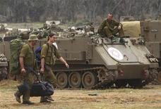 Israel começou nesta quinta-feira a retirar suas forças militares que se preparavam para invadir a Faixa de Gaza. REUTERS/Ronen Zvulun