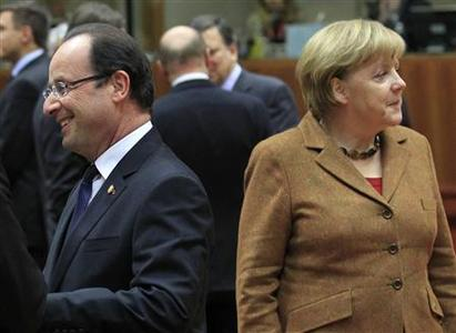 France's President Francois Hollande (L) walks past Germany's Chancellor Angela Merkel (R) during a summit of European Union leaders discussing the European Union's long-term budget in Brussels November 22, 2012. European Union negotiators believe they are close to securing British and German backing for a deal on nearly a trillion euros of spending over the next seven years, but last minute concessions may be needed to secure French and Polish support. REUTERS/Yves Herman
