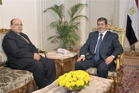 Egypt's President Mohamed Mursi (R) meets Egypt's new prosecutor general Talat Abdullah at the presidential palace in Cairo November 22, 2012. Mursi issued a decree on Thursday that protects an assembly writing the country's new constitution from dissolution and gives it extra time to finish its work. REUTERS/Egyptian Presidency/Handout