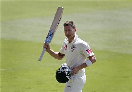 Australia's captain Michael Clarke acknowledges supporters as he walks from the Adelaide cricket ground after being dismissed for 230 runs during their second cricket test match against South Africa, November 23, 2012. REUTERS/Regi Varghese