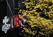 Signs are seen on the outside of Swiss bank UBS in central London November 20, 2012. Former UBS trader Kweku Adoboli was convicted on Tuesday of the biggest fraud in British history, which resulted in a loss of $2.3 billion for the Swiss bank. REUTERS/Luke MacGregor (BRITAIN - Tags: BUSINESS CRIME LAW)