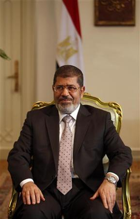 Egypt's President Mohamed Mursi attends a meeting with South Korea's presidential envoy and former Foreign Minister Yu Myung-hwan (not in picture) at the presidential palace in Cairo October 8, 2012, a day after Mursi's ''Al Nhada (Renaissance) project. The project is primarily a economic and social programme comprising of promises the president vowed to fulfil within 100 days of taking office. Mursi has won grudging respect from detractors in his first 100 days by sending the army back to barracks faster than anyone expected and raising Egypt's international profile in several newsmaking visits abroad. Yet his political fortunes and those of the Muslim Brotherhood which propelled him to power may well depend on his delivering on more mundane issues such as easing traffic congestion and bread and fuel shortages by Oct. 7 as promised. REUTERS/Amr Abdallah Dalsh (EGYPT - Tags: POLITICS)