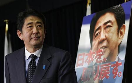 Shinzo Abe, former prime minister and leader of Japan's main opposition Liberal Democratic Party (LDP), attends a news conference at the LDP headquarters after the dissolution of the lower house was announced in Tokyo November 16, 2012. REUTERS/Toru Hanai