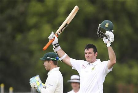 South Africa's Graeme Smith (R) celebrates reaching his century against Australia during their second cricket test match at the Adelaide cricket ground November 23, 2012. REUTERS/Regi Varghese