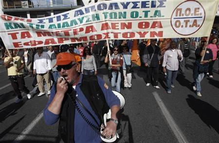 Municipality workers march during an anti-austerity rally in central Athens November 9, 2012. REUTERS/John Kolesidis