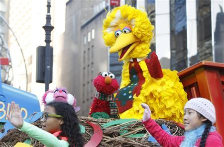 An Elmo (C) muppet is seen on a Sesame Street float during the 86th Macy's Thanksgiving day parade in New York November 22, 2012. REUTERS/Brendan McDermid