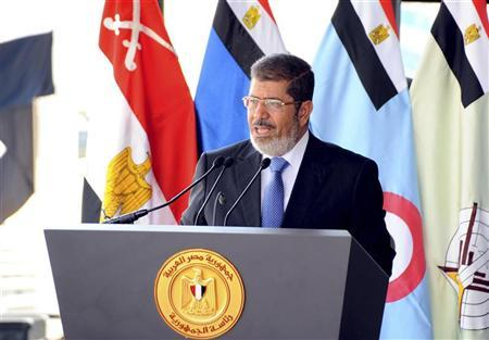 Egypt's President Mohamed Mursi speaks during his visit to the 6th armored division of the second army, in Ismailia October 10, 2012. REUTERS/Egyptian Presidency/Handout