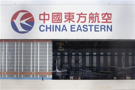 A man walks past a China Eastern airline maintenance hangar at Hongqiao airport in Shanghai June 18, 2009. REUTERS/Aly Song