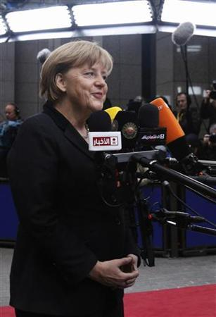 Germany's Chancellor Angela Merkel speaks to the media as she arrives at the European Union (EU) council headquarters for an EU leaders summit discussing the EU's long-term budget in Brussels November 23, 2012. REUTERS/Sebastien Pirlet (BELGIUM - Tags: BUSINESS POLITICS)