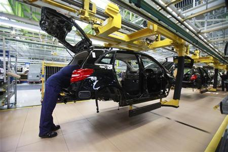 An employee of German car manufacturer Mercedes Benz works on a Mercedes B-class car at the Mercedes plant in Rastatt July 16, 2012. REUTERS/Alex Domanski