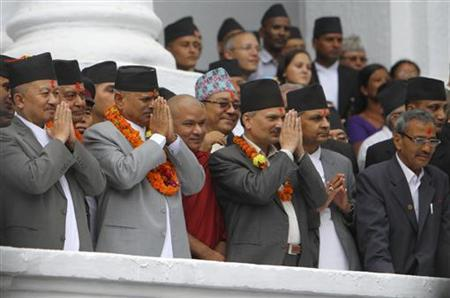 Nepalese President Ram Baran Yadav (2nd L) with Prime Minister Baburam Bhattarai (3rd R) and Speaker of the house Subash Nemwang (L) offer prayers to living Goddess Kumari at the Indra Jatra festival in Kathmandu September 11, 2011. REUTERS/Navesh Chitrakar
