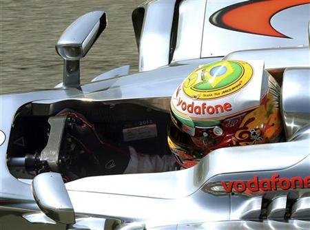 McLaren Formula One driver Lewis Hamilton of Britain powers his car during the first free practice session of the Brazilian F1 Grand Prix at Interlagos circuit in Sao Paulo November 23, 2012. REUTERS/Paulo Whitaker