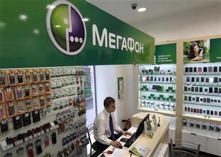 An employee works inside a MegaFon shop in St. Petersburg November 15, 2012. REUTERS/Alexander Demianchuk