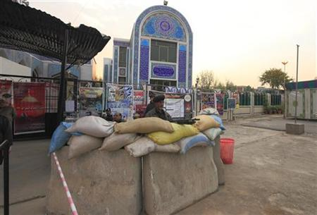A policeman guards the entrance of the Yaadgar Hussain Mosque ahead of Ashura ceremony to mark the death of Hussein, the grandson of Prophet Mohammad, in Islamabad November 23, 2012. REUTERS/Faisal Mahmood