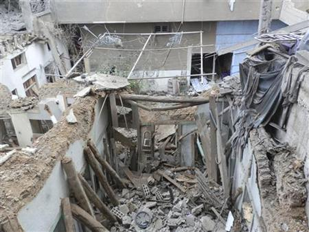 General view of damaged buildings after a Syrian Air Force fighter jet loyal to Syria's President Bashar al-Assad fired missiles at Daria near Damascus November 23, 2012. REUTERS/Fadi Al-Derani/Shaam News Network/Handout