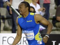 Aries Merritt of the U.S. competes in the men's 110m hurdles event at the IAAF Diamond League athletics meeting, also known as Memorial Van Damme in Brussels September 7, 2012. Merritt set a new world record of 12.80 seconds REUTERS/Eric Vidal