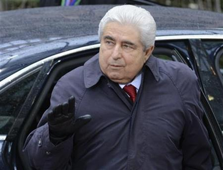 Cyprus' President Demetris Christofias gestures as he arrives at the European Union (EU) council headquarters for an EU leaders summit discussing the EU's long-term budget in Brussels November 23, 2012. Prospects of a deal on the EU's long-term budget dimmed on Friday after a fresh compromise proposal offered concessions to France and Poland but ignored British and German demands for deeper overall spending cuts. REUTERS/Eric Vidal (BELGIUM - Tags: POLITICS BUSINESS)